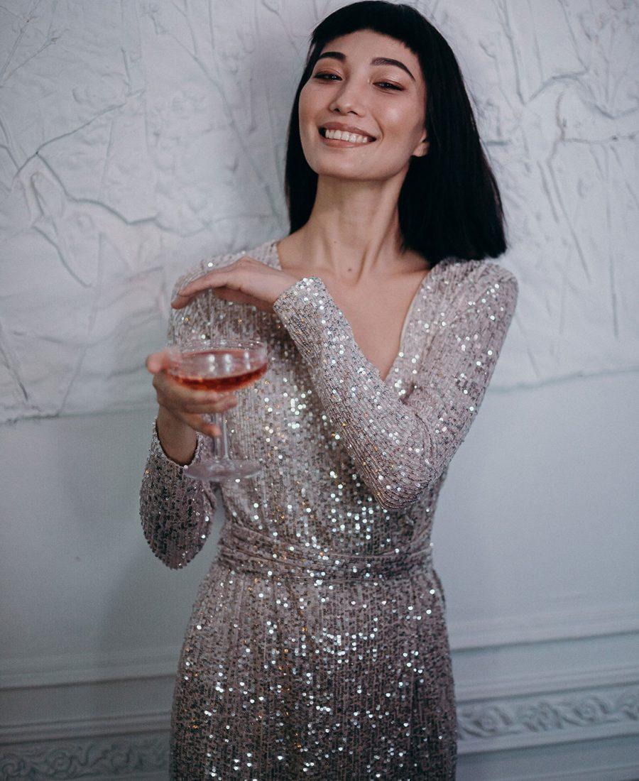 photo-of-woman-wearing-silver-dress-while-holding-cocktail-3402700